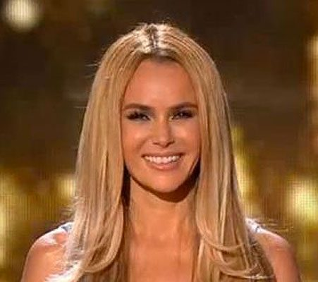 Amanda Holden Shrugs Off Criticism And Shows Off Ample