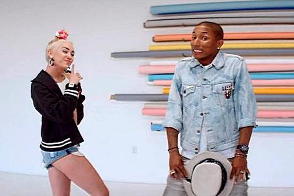 Now that's one cheeky grin, Pharrell