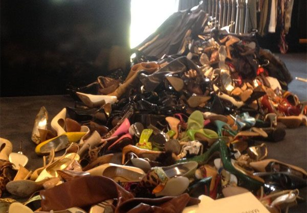 Victoria Beckham piled up her shoes before they go on sale for the British Red Cross Shop Drop