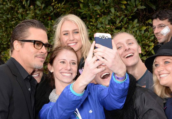 Brad Pitt went on a selfie spree at last night's Maleficent premiere