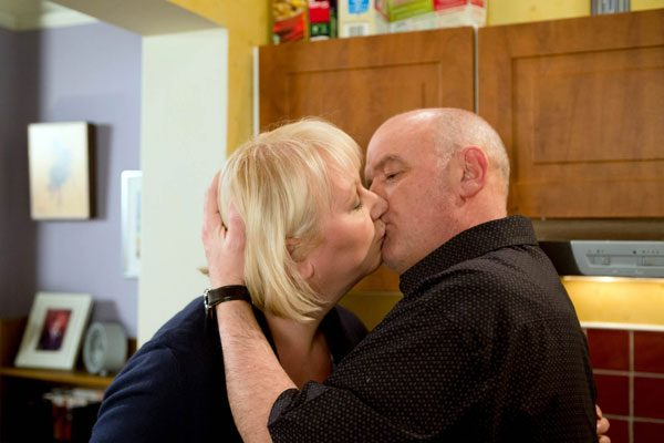 Eileen Grimshaw and Pat Phelan share a kiss on Coronation Street