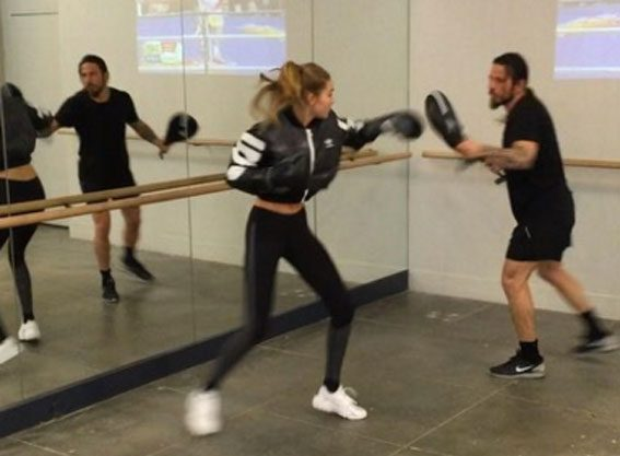 Gigi Hadid throws a punch