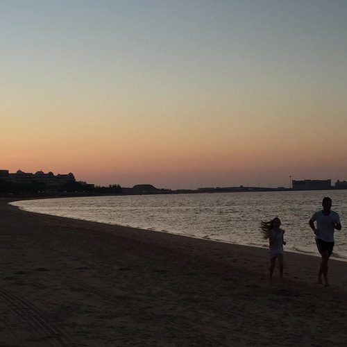 Frank can be seen running along the beach with his daughter in this cute honeymoon photo