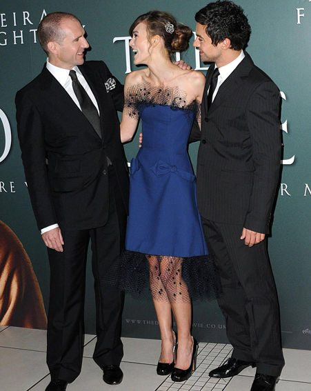 Keira shares a joke with co-stars Ralph Fiennes and Dominic Cooper