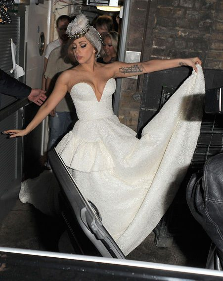 Lady Gaga posed as she arrived at The Arts Club in the white wedding frock