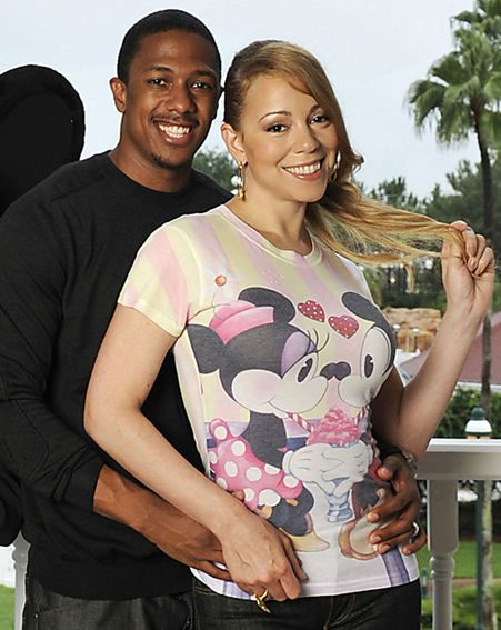 Mariah and Nick look happy as they pose together