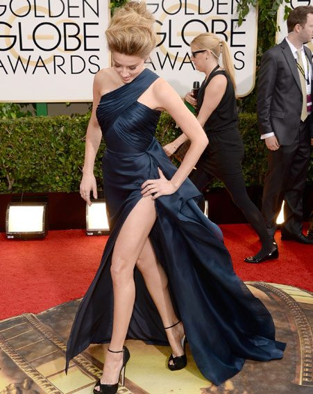 Amber Heard clung on to her frock as she paraded her toned pins