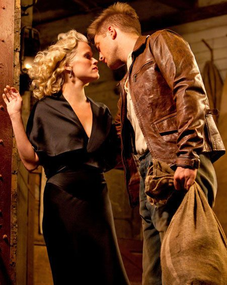 Robert Pattinson leans in to kiss Reese Witherspoon in this brand new Water For Elephants still