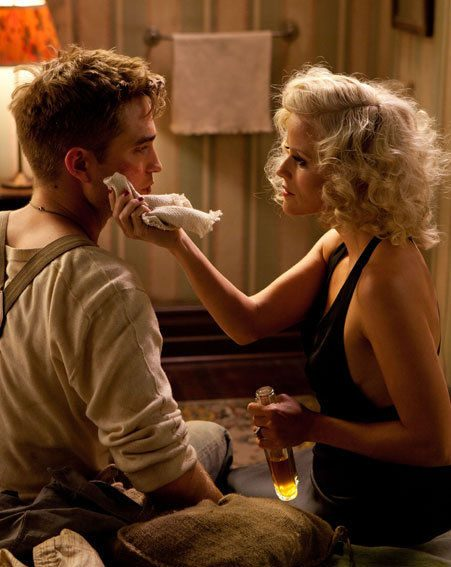 Robert Pattinson and Reese Witherspoon look incredibly sexy in this Water For Elephants still
