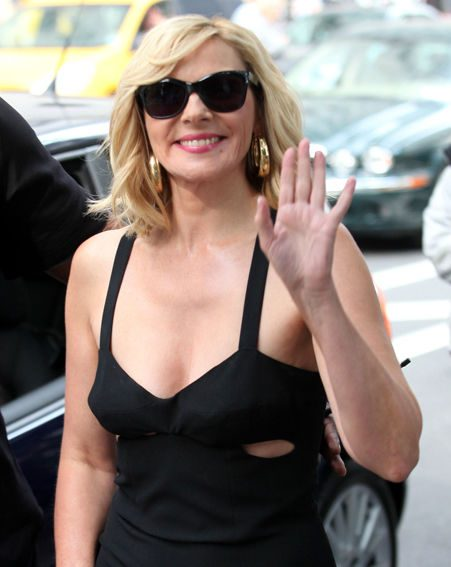 Kim Cattrall looked happy to be back on set