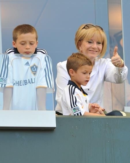 Coming Beck home? Romeo and Brooklyn Beckham with their grandmother, Jackie Adams