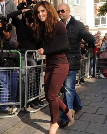 Cheryl Cole hit the Radio 1 studios in a claret jeans and wool jumper combo