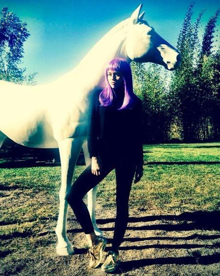 Miley Cyrus randomly posed with a horse before dressing up for Halloween