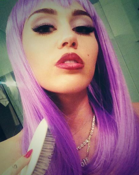 The Wrecking Ball singer finished her Halloween look with a statement purple wig
