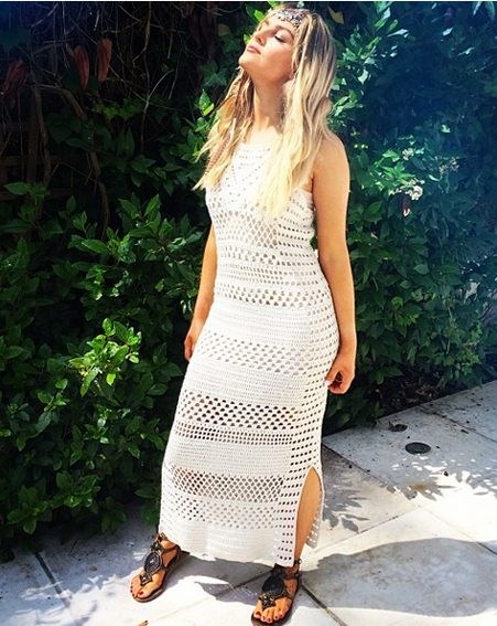Perrie was so excited she even had to have two outfits including this long crocheted white dress
