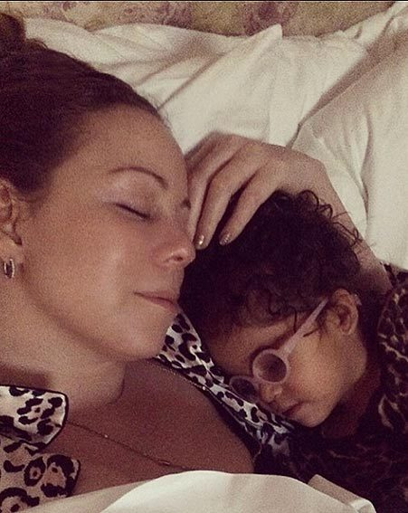 Mariah Carey shows off her soft side as she cuddles with her little one