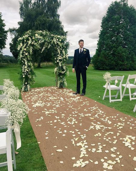Zoella shared a snap of Jim waiting for his bride at the end of the aisle