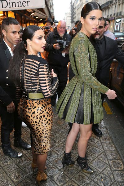 The top model towered over her older sister as they made their way to the Balmain show