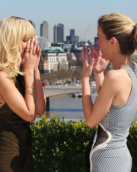 Rihanna and Brooklyn Decker found something highly amusing at the Battleship photocall
