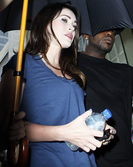Megan Fox's pale face powder was highlighted by the camera flashes