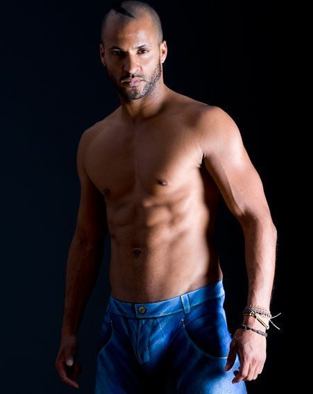 Ricky Whittle has stripped down to his jeans to show off his rippling muscles