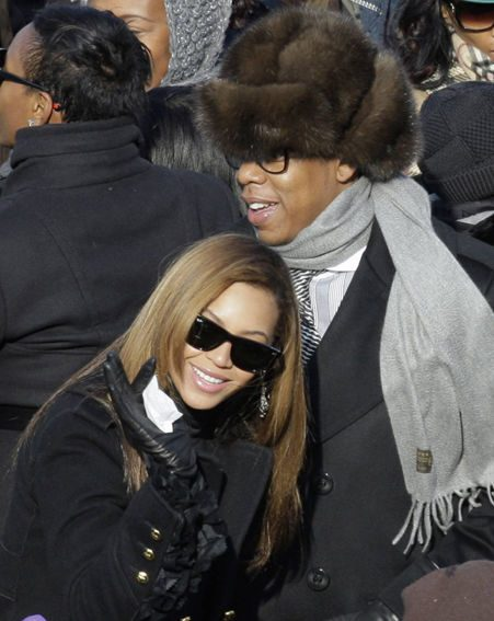 Beyonce Knowles stands with husband Jay-Z