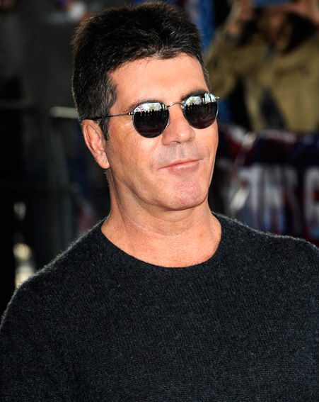 Simon Cowell came face-to-face with the female intruder at his home