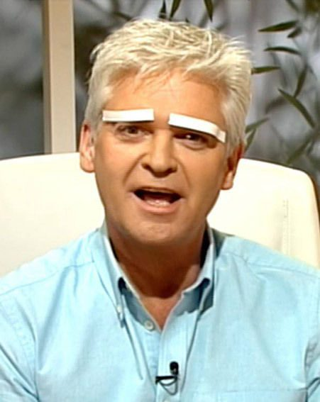 Phillip Schofield covers his brows with white tape on This Morning/ITV