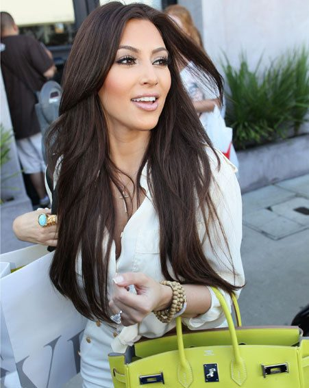 Kim Kardashian was looking very pleased when she left Vera Wang yesterday