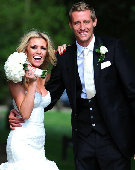 Abbey Clancy and Peter Crouch looked happier than ever as they posed together