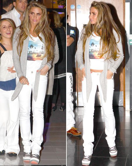Katie showed off her uber-toned figure in her tight white denims