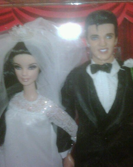 Russell Brand then posted this picture of the Elvis and Priscilla Presley Barbie wedding dolls