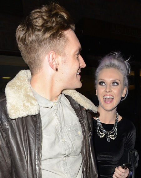 Perrie Edwards giggles with a male friend while boyfriend Zayn Malik tours with One Direction