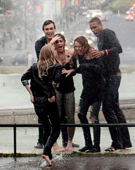 Twilight star Ashley Greene and Miley Cyrus were spotted getting drenched in Paris/ Wenn.com
