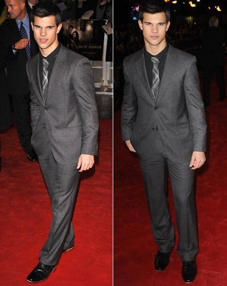 Buff Taylor Lautner looked sharp in a charcoal suit