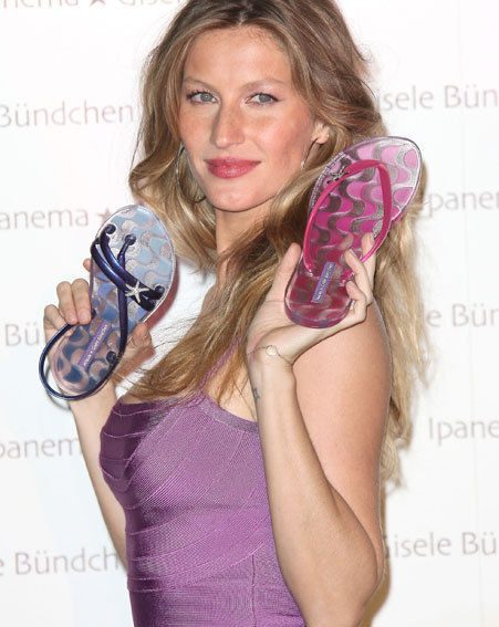 Gisele should know wearing some flip-flops too often could wreak havoc with her feet/ Wenn.com