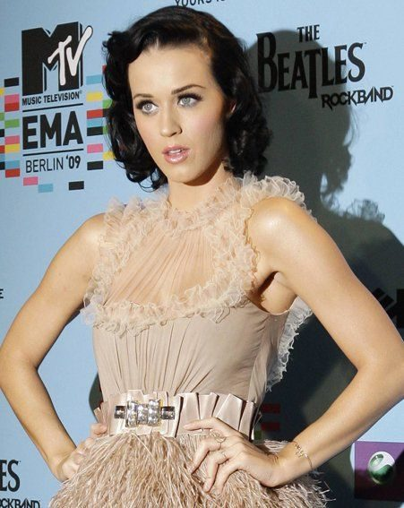 Katy says boyfriend Russell makes her naughtier