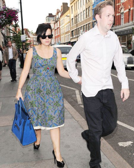 Lily Allen turned up to the fashion photography event glued to the arm of boyfriend Sam Cooper
