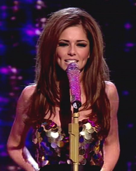 Judge Cheryl Cole performed with Girls Aloud live on X Factor