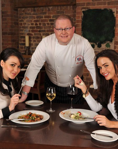 Head chef Paul Askew joins the girls to see how they're enjoying their meals (photos by Dave Nelson)
