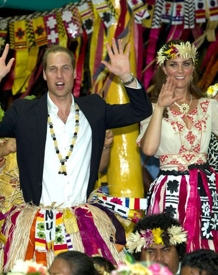 Prince William and Kate Middleton danced in grass skirts as they won their injunction