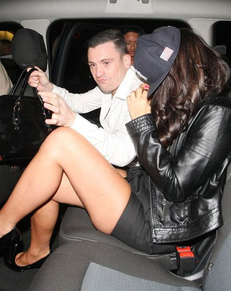 Tulisa hides her face from the cameras after split from N-Dubz boyfriend Fazer