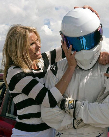 Cameron Diaz gets to grips with the Stig's helmet on Top Gear