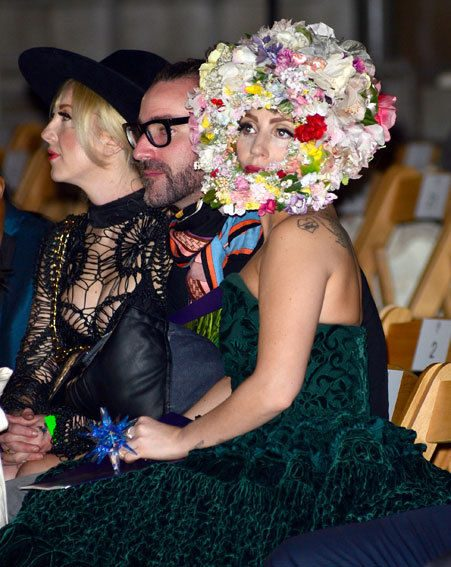 Lady Gaga wore a floral headpiece to watch the Philip Treacy catwalk show