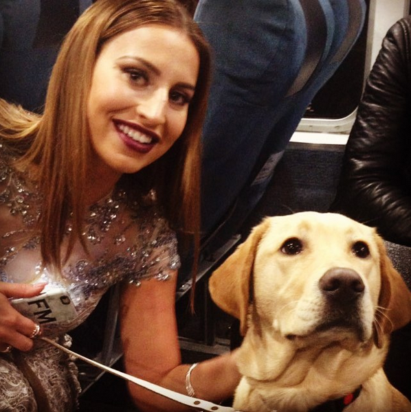 Clover cuddled up to Ferne McCann on the National Television Awards red carpet