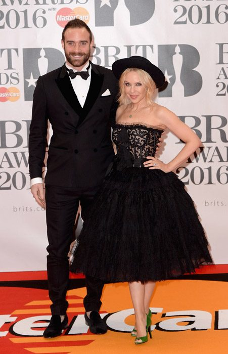 Kylie Minogue and fiancé Joshua Sasse put on a loved-up display at the BRIT Awards 2016