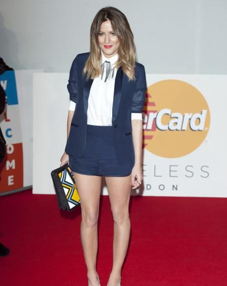 Caroline Flack goes for a cute and simple blazer and shorts combo at the 2012 Brits