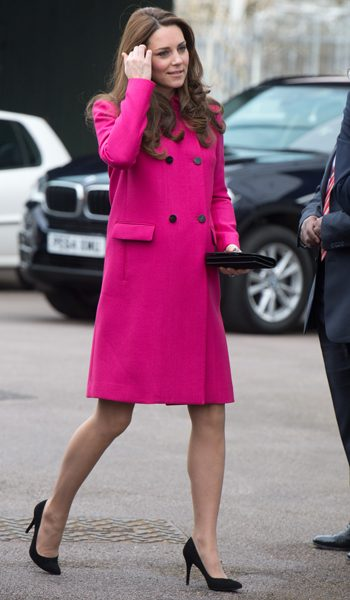 The pregnant Duchess of Cambridge looked ready to pop in the pink Mulberry coat