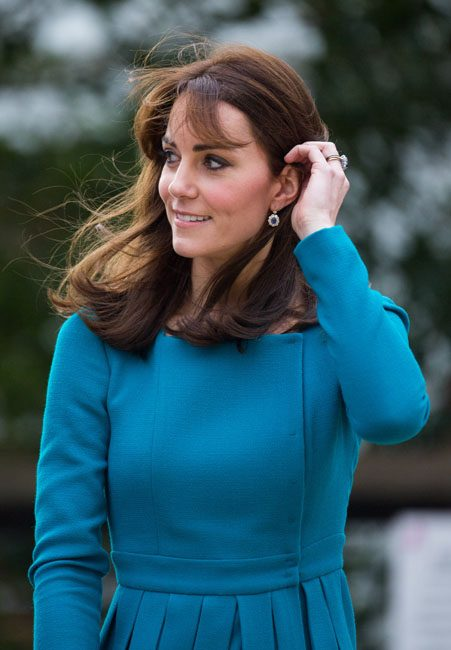 Kate Middleton managed to control her tresses in the wind as she stepped out for her third public outing this week