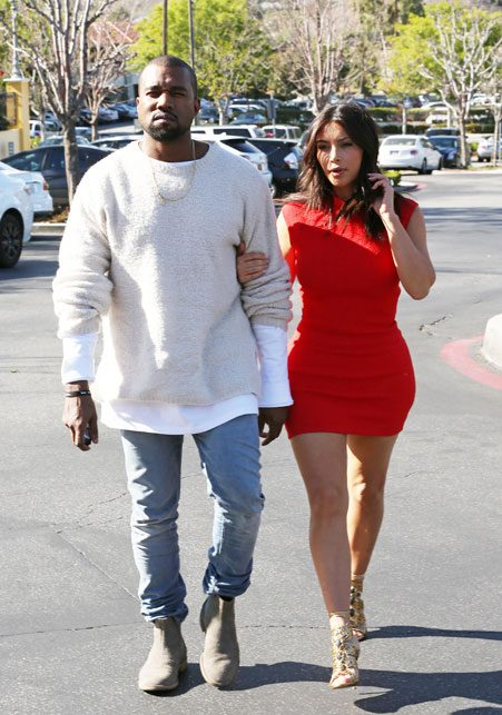 Kim and her fiancé rapper Kanye West walked arm in arm as they walked into the cinemas to see a film